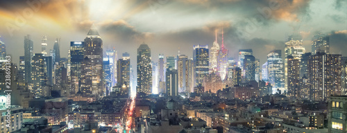 In de dag New York City Midtown Manhattan aerial view at night as seen from Hell's Kitchen rooftop