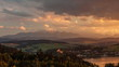 Landscape of Sunset and Clouds over Village and Lake in a Mountain Valley.