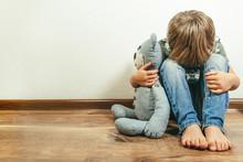 Sad Depressed Boy With Teddy B...