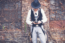 Retro Styled Man Taking Picture With Vintage Photo Camera.
