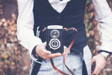 Close Up Of Man With With Vintage Medium Format Photo Camera.