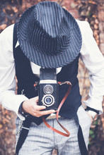 Unrecognizable Photographer Taking Picture With Medium Format Camera.