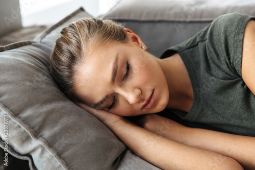 Lovely young womansleeping on a couch at home