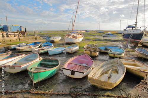 Colorful boats at low tide, located along the Thames Estuary, Leigh on Sea, UK Canvas Print