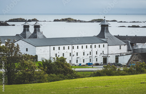 Fotografie, Obraz Laphroaig distillery buildings on the Islay island shore