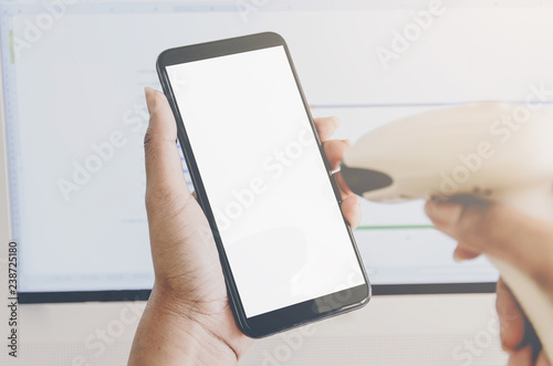 Foto  Concept of shopping and human hands are holding smartphone with barcode reader