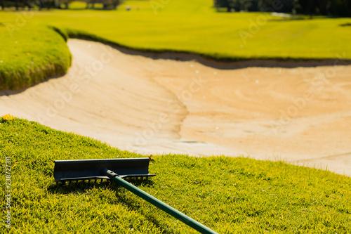 Fotografija Sand Bunker Hazard and rake on Golf Course Fairway