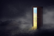 Open Wooden Door To The New World With Green Environment. Climate Change Concept. Day Concept. Night To Daylight