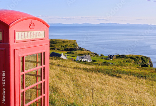 Obraz na plátně  Lonely red phone booth in a rural landscape at Isle of Skye, Scotland, UK