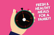 Leinwandbild Motiv Handwriting text writing Fresh And Healthy Meals For A Family. Concept meaning Good nutrition taking care of health Hu analysis Hand Holding Mechanical Stop Watch Timer with Start Stop Button