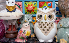 Different Figurines Of Owls In The Gift Shop.