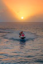 Professional Rider Man Drive Freestyle Jet Ski On The Wave At Sunset , Alanya Turkey