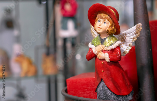 Fotografie, Obraz  Vintage figurine of a girl in a red cloak with angel wings.