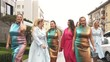 Beautiful women in fashion dresses defile on the street. Plus size Fashion Week. Slow motion.