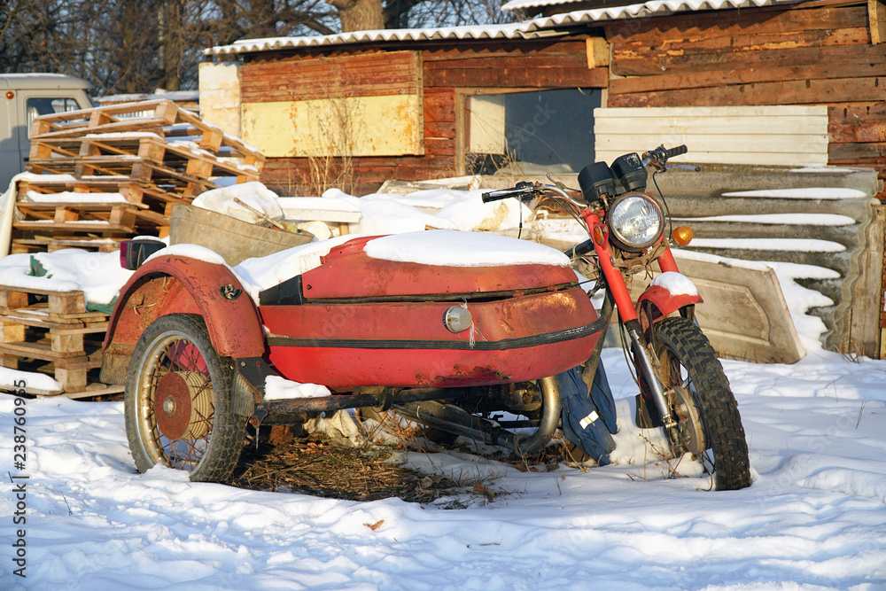 Fototapeta Old abandoned motorcycle with sidecar