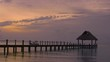 A wooden pier. sunset time on the island of Cozumel, mexico. the Caribbean sea