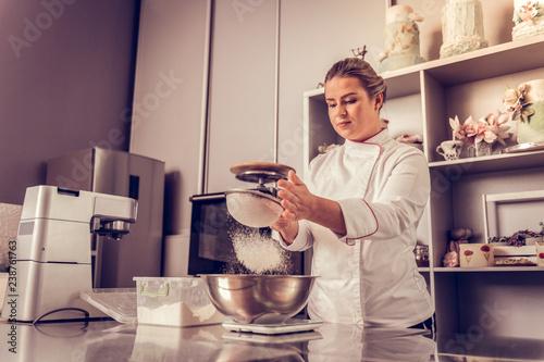 Fototapeta Pleasant skilled woman preparing a tasty cake obraz na płótnie