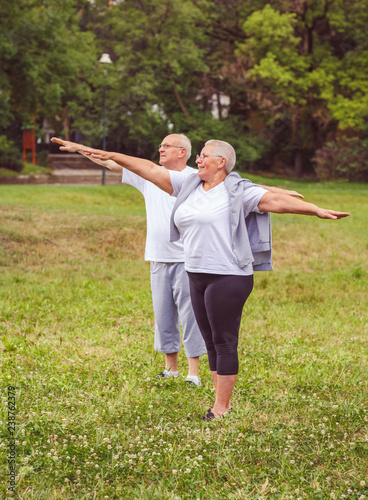 Fotografie, Obraz  Senior exercise - healthy aged couple resting after sport exercises- together we workout better