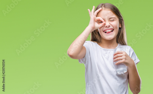 Fotografia Young beautiful girl drinking glass of water over isolated background with happy