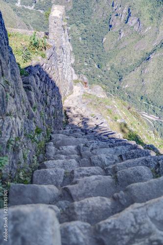 Stone stairs climbing Machu Picchu peak in  Peru Canvas Print
