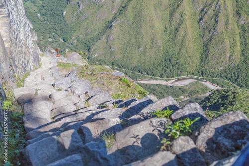 Stone stairs climbing Machu Picchu peak in  Peru Wallpaper Mural
