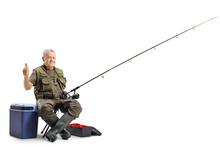 Elderly Fisherman Holding His ...