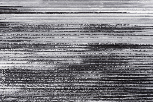 Foto  black and white painted corrugated paper background texture