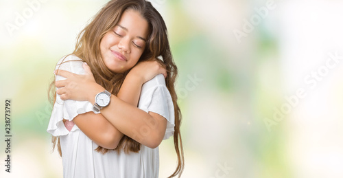 Photo  Young beautiful brunette business woman over isolated background Hugging oneself happy and positive, smiling confident