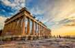 Low angle perspective of columns of the Parthenon at sunset, Acropolis, Athens