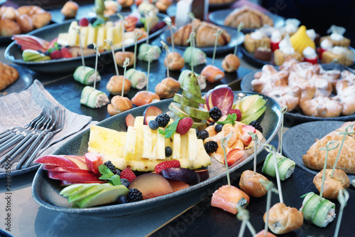 Deurstickers Assortiment Various food on catering table, toned