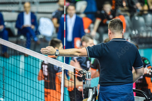 Volleyball referee gives sign who score the point