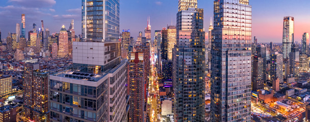 Aerial view of New York City skyscrapers at dusk as seen from above the 42nd street canyon