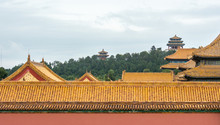 Jingshan Park In Background With Wanchun Pavilion On Top Of Prospect Hill, Forbidden City Rooftops In Foreground, Beijing, China.