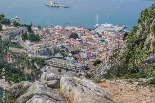 Fotografia  old medieval city on sea shore line with small harbor aerial shot on south Europ