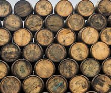 Stacked Pile Of Old Wooden Barrels And Casks At Speyside Cooperage In Scotland