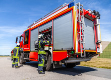 German Fire Engine With Fireman Arround Stands On A Accident