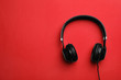 canvas print picture - Stylish modern headphones with earmuffs on color background, top view. Space for text
