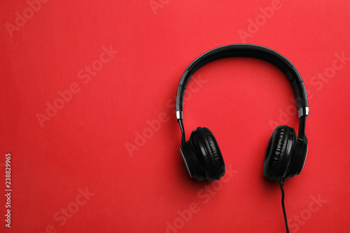 Fotografie, Obraz  Stylish modern headphones with earmuffs on color background, top view