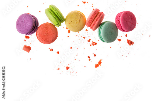 Aluminium Prints Macarons Flat lay, top view. French macaroons isolated on white background. Cookies falls mixed with crumbs. Copy space.