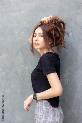 Attractive beautiful woman is walking on street in a city in summer