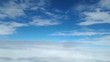 View from the window of the plane on the white clouds, the flight between the clouds