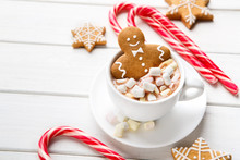 New Year Gingerbread In Cup Of Cocoa On White Background
