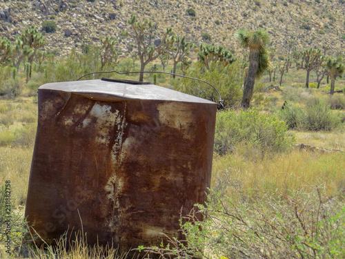 Old rusty water tank in the desert Joshua Tree - Buy this stock