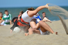Playing Rugby At The Beach. Team Sport