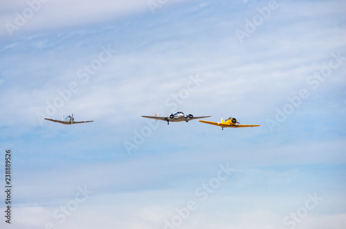 Fotografering  squadron of old planes flying in an air show