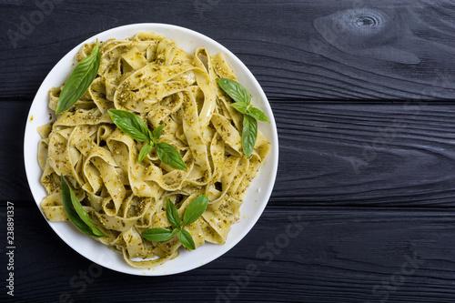 Pasta tagliatelle with green sauce pesto Obraz na płótnie