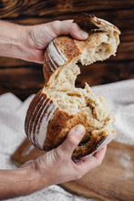 Man Breaks Hands A Loaf Of Fre...