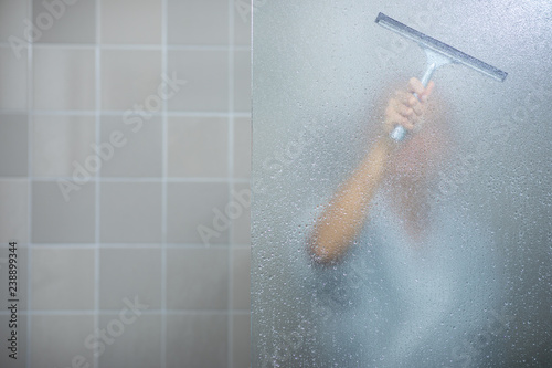 Fotografie, Tablou  Woman  in a modern design bathroom