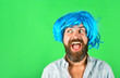 canvas print picture - Funny bearded man wearing blue wig. Handsome bearded man with stylish mustache in wig. Fashion, art and creativity concept. Barbershop. Hipster in periwig. Happy stylish man in blue hair. Copy space.