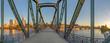 eiserner Steg, famous iron footbridge crosses river Main in Frankfurt with skyline in morning light